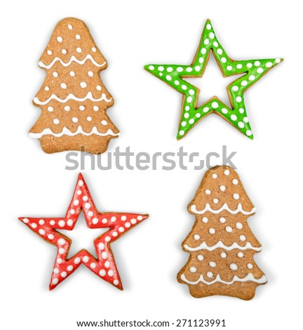 Food. Christmas Ginger and Honey cookies on isolated white background. Star, fir tree, snowflake shape.