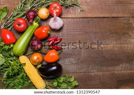 Food concept. Flat lay of different vegetables on old wooden table and copy space. Horizontal image. #1312390547