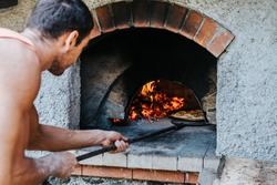 Food concept. Preparing traditional italian pizza. Baked pizza in the front of the oven.