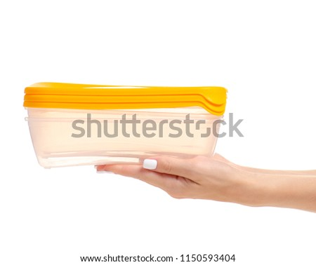 Food containers in hands on white background isolation