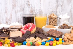 Food containing a lot of sugar. Too much sugar in diet causes obesity, diabetes and other health problems