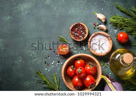 Food cooking ingredients on dark stone table. #1029994321