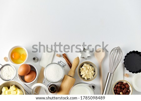 food, culinary and recipe concept - cooking ingredients and kitchen tools for baking on table Stock fotó ©