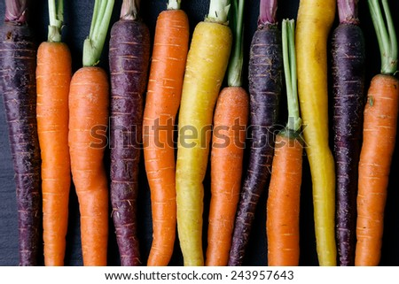Food. Delicious carrot on the wooden table