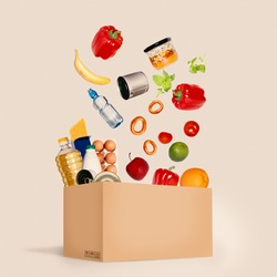 Food delivery concept. Donation box fresh vegetables, fruits and food. Safe home. Flying food.