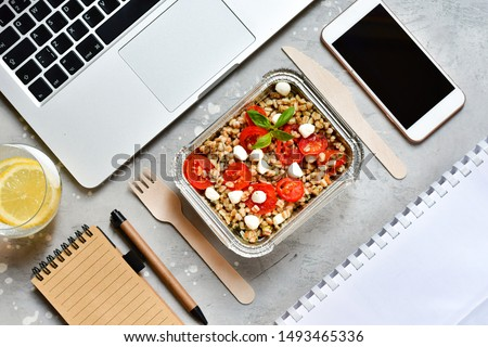 Food delivery. Lunch box with a diet lunch or breakfast or dinner on grey office table. takeaway lunch at the office. Top view . takeout healthy lunch. selective focus