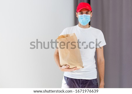 food delivery man in protective mask