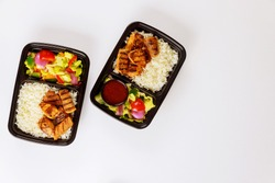 Food delivery or order. Ready meal to eat on food container isolated.