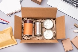 Food delivery service, canned food in cardboard box