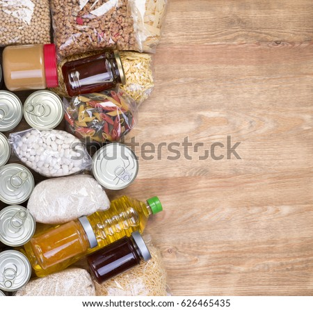 Food donations on wooden background, top view with copy space #626465435