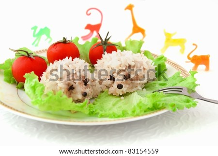 Food for children, two funny rice hedgehogs on the white background - stock photo