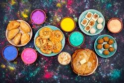 Food for Indian Holi party. Laddu, gujiya, puran poly, thandai, malpua and burfi