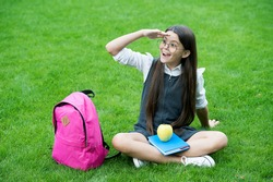 Food for sight. Happy child look into distance on green grass. School snack. Vision care and eye check. Eye sight protection. Eye health education. Pediatric ophthalmology. Improve sight naturally.