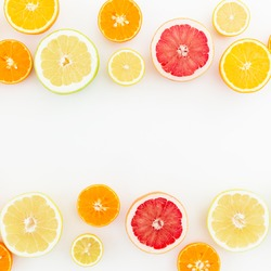 Food frame of fresh citrus fruits isolated on white background. Flat lay, top view.