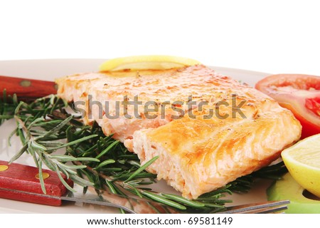 food: grilled salmon on big glass plate isolated on white background