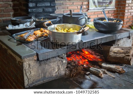 Food heated on a wood burning stove, a traditional farmhouse cooking in Brazil.