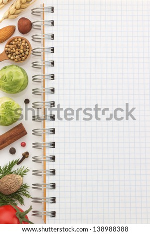 food ingredients and recipe book on white background