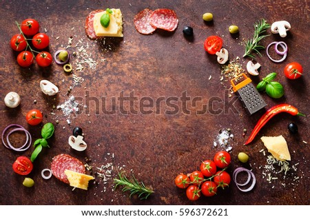 Food ingredients and spices for cooking pizza. Mushrooms, tomatoes, cheese, onion, oil, pepper, salt, basil, grater, olive on rustic background. Copyspace. Top view #596372621