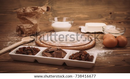Food ingredients for dough a wooden kitchen board. Cake recipies. Close up