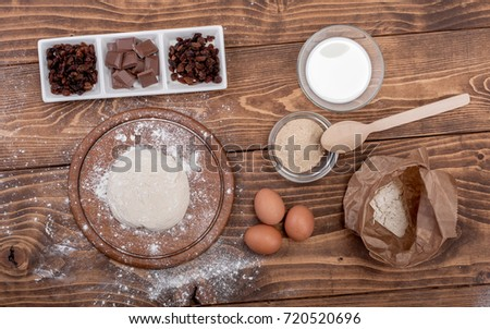 Food ingredients for dough a wooden kitchen board. Cake recipies. Top view