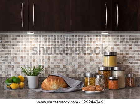Food ingredients in a contemporary kitchen with cozy lighting.