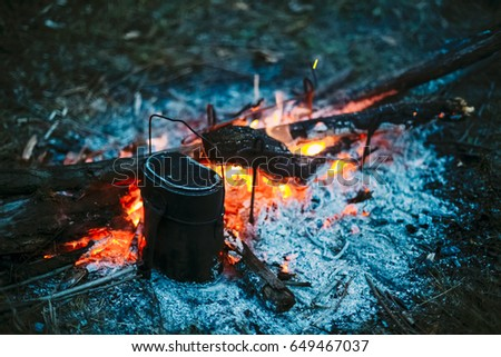 food is cooked over a fire in...