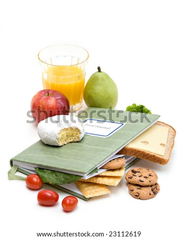 Food Journal or diary surrounded with different foods.  Health and diet concept.