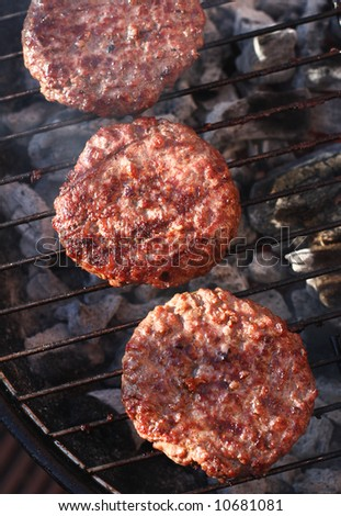 food meat - burgers on barbecue. Shallow dof.