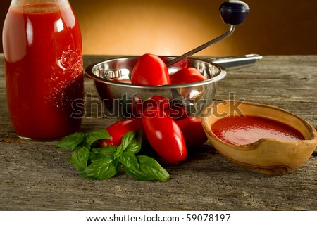 food mill with tomatoes and sauce
