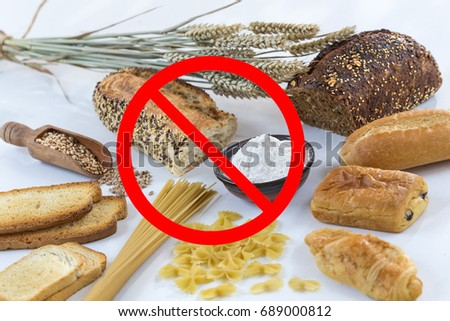 Photo of food non gluten free, with cerales grains on white with interdiction symbols