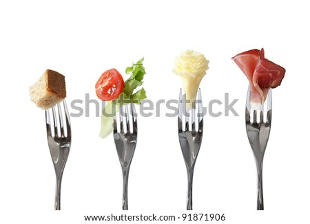 Food on forks: bread, vegetable, cheese and meat - four basic nutrition