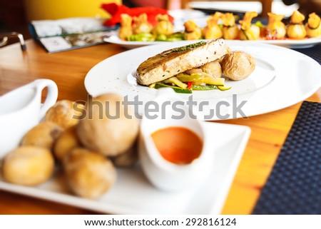 food on white plates, sea potatoes and tuna