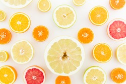Food pattern. Lemon, orange, grapefruit, sweetie and pomelo on white background. Flat lay, top view.