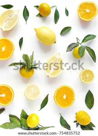 Food pattern of fresh fruit in a cut. Oranges, lemons slices , tangerines with green leaves. Composition from fruits, top view, flat lay. Citrus fruits background, wallpaper.