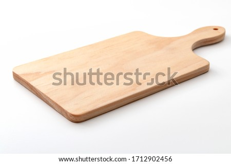 Food preparation tool and kitchen utensils concept with close-up on rectangular wood chopping board with round corners isolated on white background at an angle perspective with clipping path cutout Stockfoto ©