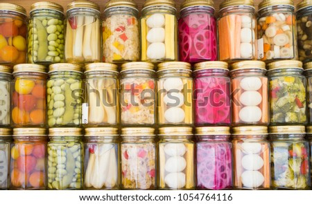 Food preservation colorful pickled fermented food preserved jar. preserving pickles glass organic. preserves jars pickled canning vegetable cucumber pickle winter.
