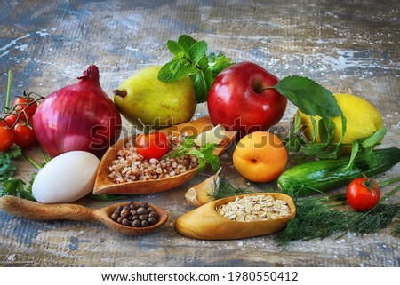 Food products for active lifestyle and diet. Healthy food: porridge, vegetables, fruits and spices. Different appetizing food on grey art background Stock photo ©