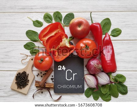 Food rich in chromium with the symbol Cr and atomic number 24. Natural sources of chromium: apple, bell pepper, spinach, tomato, onion, black pepper corn, cinnamon. Healthy food containing chromium. Photo stock ©