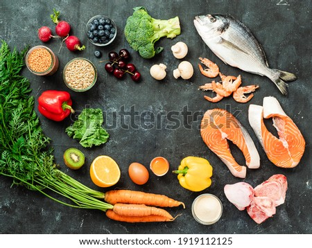 Food rich in collagen concept. Various food ingredients and chalkboard with copy space in center over dark background. Top view or flat lay Photo stock ©