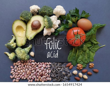 Food rich in folic acid or vitamin B9. Natural food sources of folic acid: avocado, cauliflower, broccoli, eggs, tomato, spinach, beans, nuts, parsley. Various food ingredients with Folic acid letters