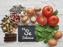 Food rich in selenium, with the symbol Se and atomic number 34 for the chemical element selenium. Natural healthy sources of selenium. Spinach, dark chocolate, egg, mushroom, bean, garlic, seeds, nuts