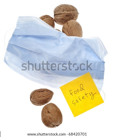 Food Safety Reminder with Fresh Walnuts and Surgical Mask Isolated on White with a Clipping Path.