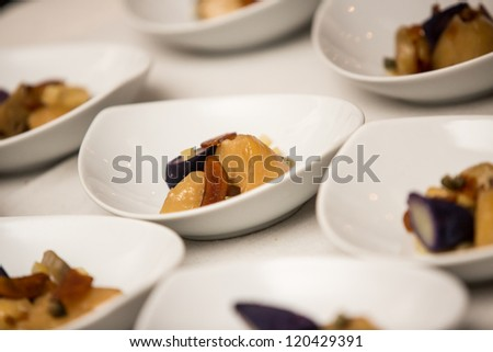 Food served in white plates ready to be eaten.