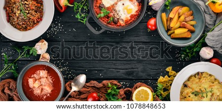 Food. Set of dishes on the table. On a wooden background. Top view. Copy space.