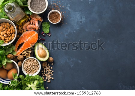Food sources of omega 3 and healthy fats on dark background top view. Copy Space. Vegetables, seafood, nut and seed Сток-фото ©