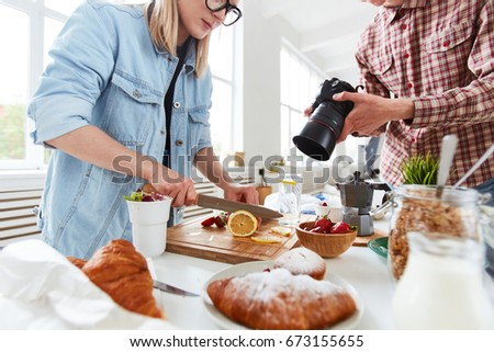 Shutterstock Food-stylist and food-photographer getting ready for shooting food-advert