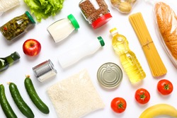 Food supplies for the period of quarantine on white background. Set of grocery items from canned food, vegetables, pasta, cereal. Food delivery concept. Donation concept. Top view.