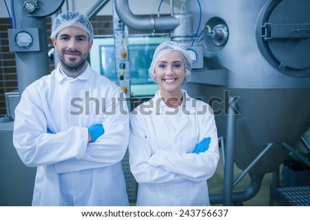 Food technicians smiling at camera in a food processing plant