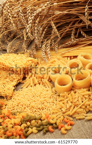 Food theme: uncooked pasta background.