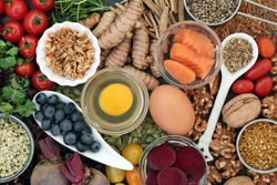 Food to promote brain power and memory concept with nuts, seeds, herbs, vegetables, fruit, dairy and fish. Super foods high in vitamins, antioxidants, omega 3 fatty acids, Immune boosting.